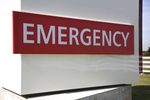 A red sign with white letters saying emergency.