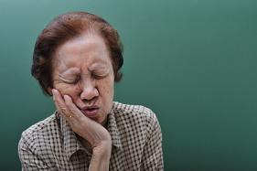 An old woman suffering from gum disease.